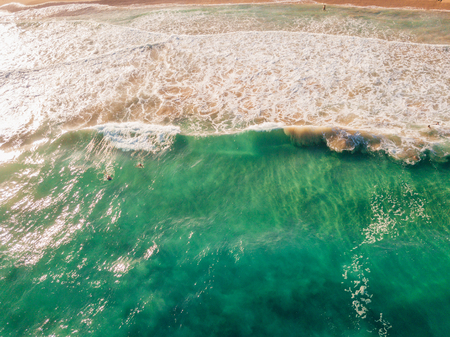Amazing aerial view of the Hawaii nature, beach, Pacific ocean waves during sunset time. View on the beach at the Kauai island
