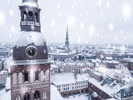 Amazing aerial view of the Riga old town (vecriga) in January during barracades memorial winter day. Snowing in Latvia.