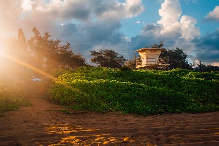 Amazing sunset at the Kauai beach on Hawaii.