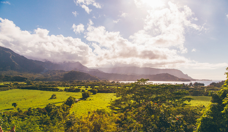 Beautiful nature on the Kauai island, Hawaii, USA. Panoramic view on mountains, rivers, fields and waterfalls.