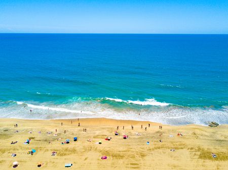 Aerial view of the beach by the Atlantic ocean and Maspalomas dunes.