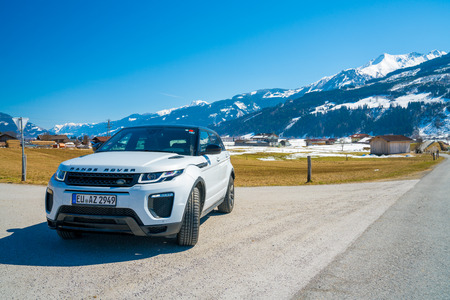 White Range Rover Evoque. Austria, Alps - March 25, 2018: Latest brand new white 2018 Range Rover Evoque. Beautiful car SUV in the nature deep in Alps. Range Rover bestselling model in the wild. Publikacyjne
