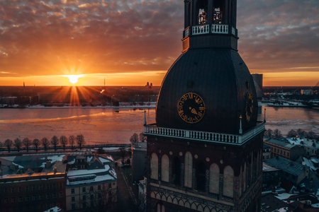 5 January 2019. Riga, Latvia. Beautiful sunset over Riga old town during cold winter day. View from the main Domes cathedral on the river Daugava, national library and the old town. Reklamní fotografie