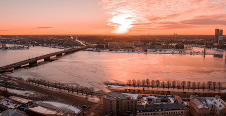 5 January 2019. Riga, Latvia. Aerial winter sunset view over Riga old town with Dome cathedral and river Daugava in Latvia.