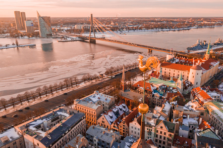 5 January 2019. Riga, Latvia. Golden cock on the top of the Dome Cathedral during sunset. Beautiful Riga wallpaper.