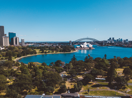 Aerial view on the Sydney harbour from above with city skyline, botanic garden, park and of course the Harbour bridge.  Sydney. Australia. August 30, 2017.