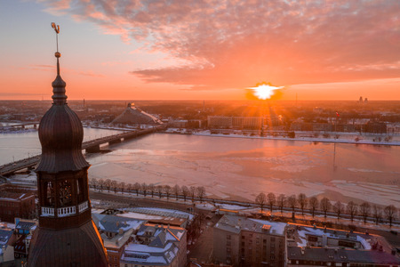 5 January 2019. Riga, Latvia. Aerial winter sunset view over Riga old town with Dome cathedral and river Daugava in Latvia