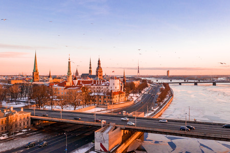 5 January 2019. Riga, Latvia. Beautiful aerial winter view over Riga old town with Dome cathedral and river Daugava during sunset. Amazing Latvia.