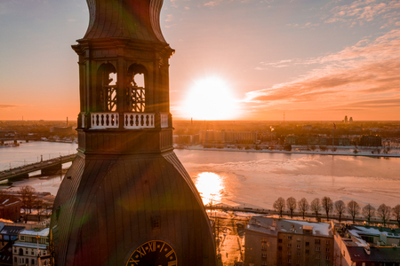 5 January 2019. Riga, Latvia. Beautiful sunset over Riga old town during cold winter day. View from the main Domes cathedral on the river Daugava, national library and the old town
