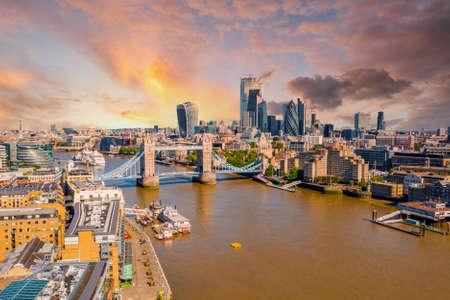 Tower Bridge in London, the UK. Bright day over London. Drawbridge opening.