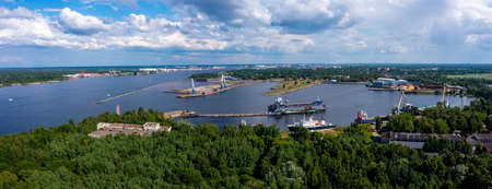 Riga, Latvia. June 10, 2021. Cargo ship at floating dry dock is being renovated