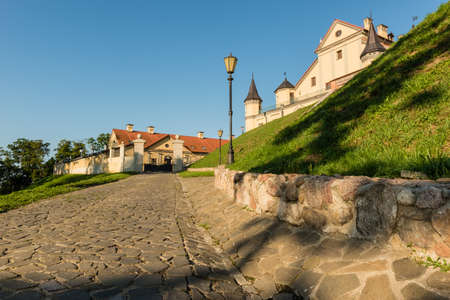 cobblestone road: Nesvizh, Belarus - August 20, 2016: Nesvizh Castle is a residential castle of the Radziwi family. Cobblestone road to the castle.