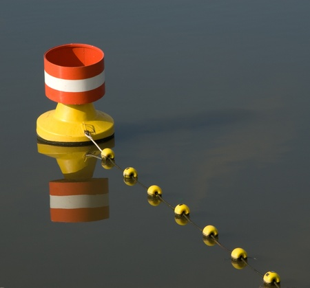 navigation aid: Buoy with floats at a rope