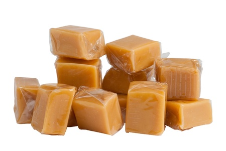 cling: Light brown caramel sweets in plastic wrap, isolated