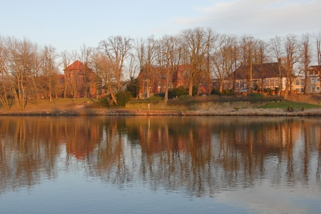 historically: Small town Nienburg at the river Weser with the historically building Stockturm, Lower Saxony, Germany