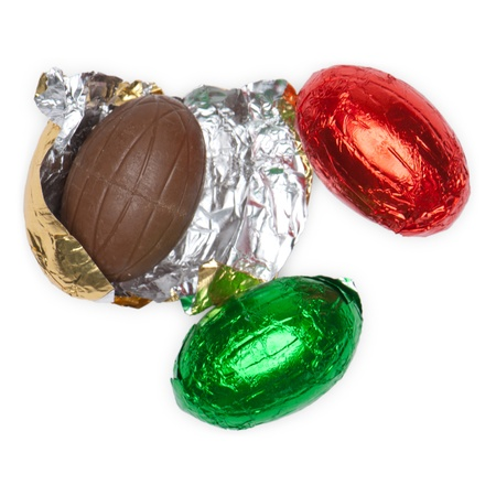 unwrapped: Easter egss made of chocolate and wrapped in colorful foil, isolated