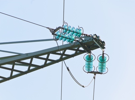 Traverse and insulators at a tension tower of a high-voltage line Stock Photo - 13284974