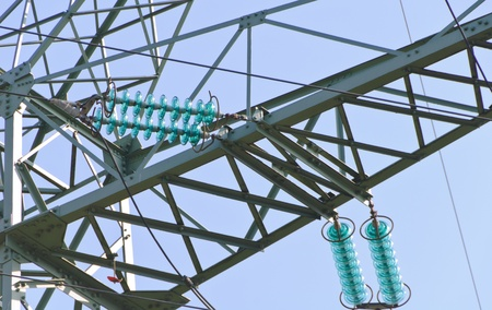 Traverse and insulators at a tension tower of a high-voltage line photo
