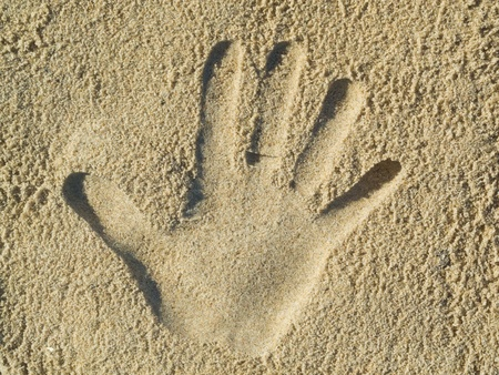 optical illusion: Optical illusion - Handprint in the sand Stock Photo