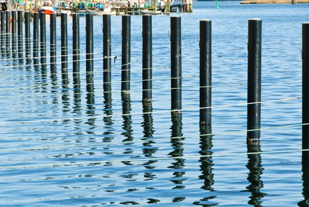 bollards: Jetty with bollards in the harbor of Kappeln