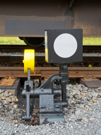 Hand-operated railroad switch with lever, weight and signal Stock Photo - 13883224
