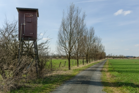 Box stand at a wayside in a hedge at a meadow photo