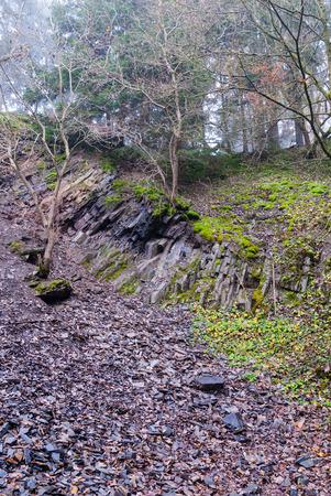 Geröll unter einem bahnbrechenden Kante in der Steinbruch in Bromberg, Medebach, Hochsauerland
