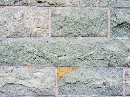 Mauer aus behauenen Steinen als Hintergrund Standard-Bild