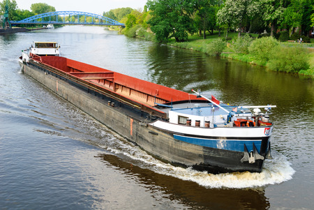 inland: Cargo ship on the river Weser near Nienburg Editorial