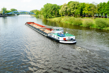 inland: Cargo ship on the river Weser near Nienburg Stock Photo