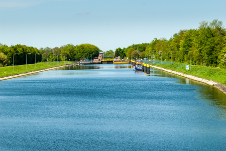Canal lock on the river Weser near Sebbenhausen with dolphins, landing stages, bridge und gate