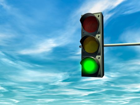 green light: City traffic light with a green signal