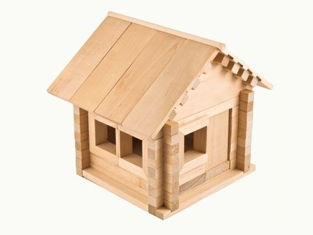 Wooden toy house. Isolated on white background