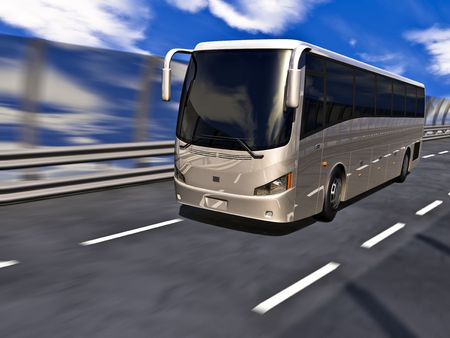 Silver tour bus on highway in motion. No trademarks