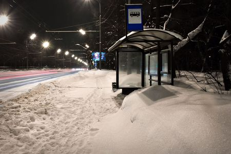 Night shot of empty bus stop in winter photo