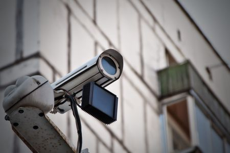 Surveillance camera is mounted on a wall