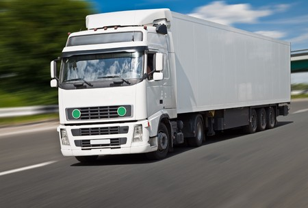 White truck on the road, blurred motion. Stock Photo