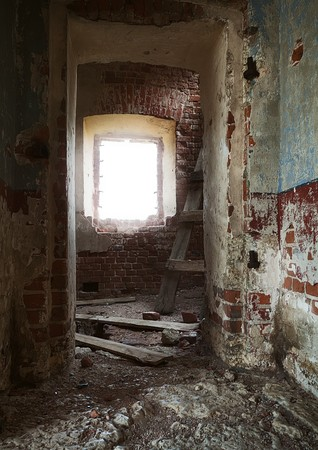 inside the ruins of an abandoned rural church Stock Photo