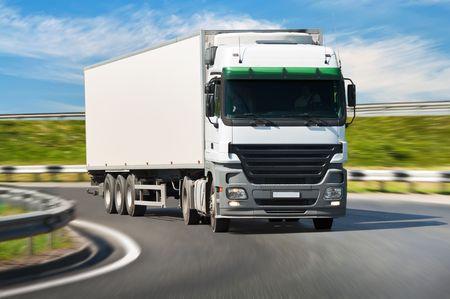 White truck on the road, blurred motion. Archivio Fotografico