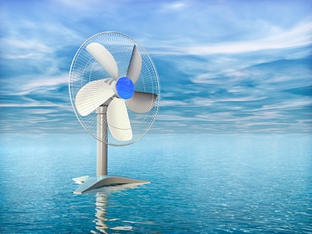 Electric fan on the background of the sea and blue sky Stock Photo