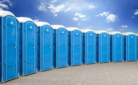 3d illustration of a group of mobile blue bio toilets. Stock fotó