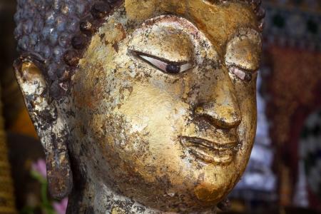 enlightment: Golden Buddha statue in public temple Stock Photo