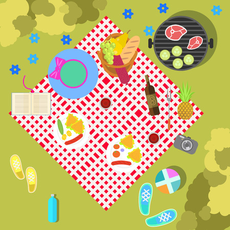 Summer picnic on nature landscape with checkered blanket and basket of healthy food, top view. Dining on green grass with bushes. Family outdoor happy holiday weekend. Activities for parents and kids