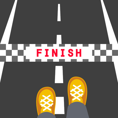 end of the line: Finish line road sign. Man feets standing on the road in front of the end stop band.