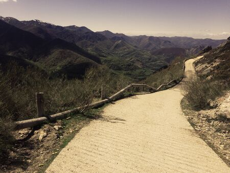 Mountain road that descends towards the valley. Route in Asturias Spain