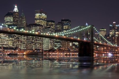 Brooklyn bridge in front of Manhattan photo