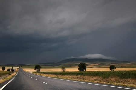 Road over the storm near Pamplona, Spain