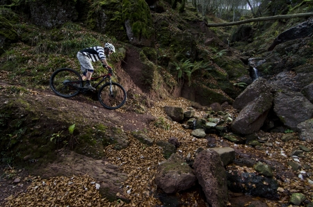descend: Rider in action at Freestyle Mountain Bike Session Stock Photo