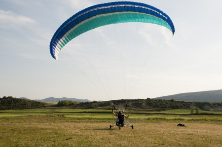 paraglide: Moto paraglider on the field
