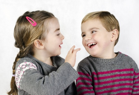 Portrait of a child, the love of brother and sister in his arms on a white background Stock Photo - 16747864